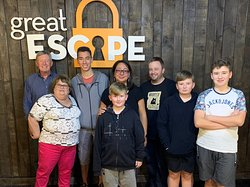 Our family after we completed the escape room. Great fun!