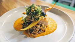 Paíche Amazónico -- An incredible dish featuring Amazonian fish with lentils, cream of carrot, and smoked spices.  Delicioso!
