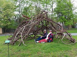 RoCA Nest 2019 by Cristina Biaggi.  Part of the Natural Progressions Exhibit in The Catherine Konner Sculpture Park April 2019 through April 30, 2020.  Built from vines on the RoCA property.  The artist and visitor enjoy the Nest habitat during the opening reception.