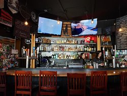 A view of the bar area and televisions