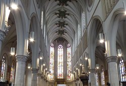 The beautiful ceiling and stained glass window in the Church of St Christophe, Tourcoing.