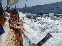 Fun dangling their legs in the water