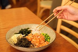 Poke bowl salmon with citrus ginger soy
