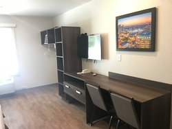 Large counter top areas, flat screen TV, telephone, clothes rack