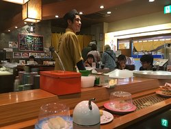 The cheerful sushi-cook.