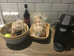 Complimentary bottle of wine and breakfast provisions