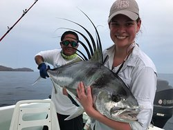 Smiling Client with her Rooster Fish - catch & release