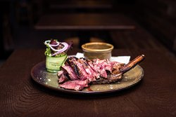 Meat Lovers  600 grams of dry aged rib eye steak that has been seasoned, smoke-infused and grilled to rare; served with duck fat potatoes, garden salad and Bearnaise sauce.