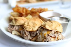 RIB ROLLS - shaved prime rib, jack and cheddar cheeses, horseradish cream sauce with au jus.