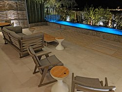 Another photo of the back patio and private plunge pool in the Gallery Grand suite.