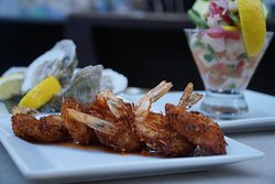 Coconut shrimp (foreground), Oysters and ceviche (background)
