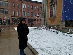 Out exploring, across the street form the inn, at Adams Museum , my wife  trying to stay warm in may