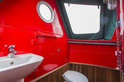 Moonraker shower,toilet and sink all under canvas in the front of the boat, with heated towel rail.
