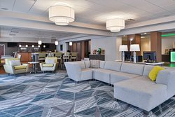 Relax in our Community Lobby Lounge with TVs and Plenty of Space