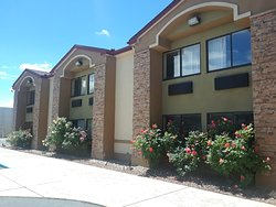 Front of Amerstone Inn & Event Center. Roses blooming.