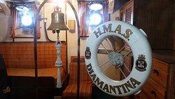 Bell and life ring from the HMAS Diamantina