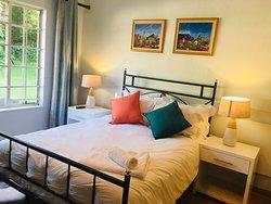 Cedar Room - view of queen bed and garden