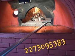 Our lovely wooden oven where you can taste our pizzas giouvetsi oven spaggeties and so many pther greek foods!