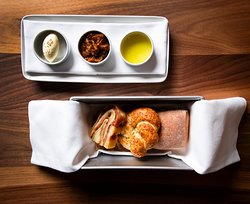 Our Breadbasket, baked fresh with a rosemary focaccia and our stromboli bread.