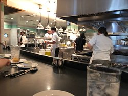 Sit at the kitchen bar and watch the chefs make every meal.