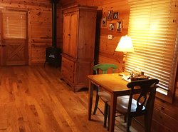 A dining area, storage armoire, & fireplace!