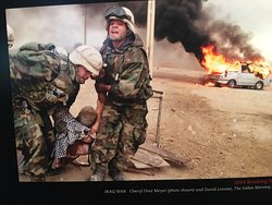 Soldiers in Iraq helping civilian