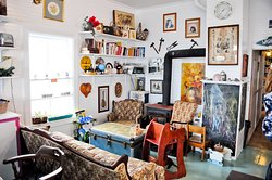 Decorated with vintage finds and a few souvenirs for sale. Family friendly.