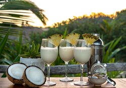 Cocktails at sunset ! We love creating tropical cocktails. The Pina Colada is one o our favourites.