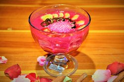 Red Devil is Smoothie Bowl with banana,dragon fruit ,water melon,topping with  banana ,black olive ,and dried coconut