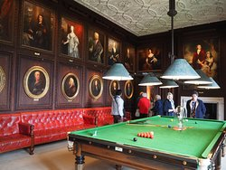 The Billiard Room with family portraits