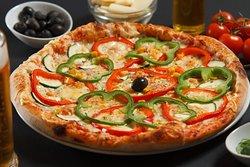 Pizza Vegetariana made of zucchini,eggplants,peppers,mushroom and corn in tomato sauce.