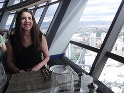 My wife and the awesome view from the Top of the World Restaurant at the Stratosphere.