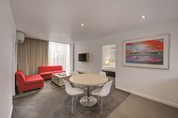travelodge hotel docklands melbourne two bedroom apartment lounge and dining