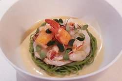 Marinated Ocean Prawns over a bed a house made green pea pasta, with micro greens and a citrus beer blanc sauce.