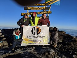 Here we are at Uhuru peak thanks to Halisi travel. Sorry about the thumb on the top :)