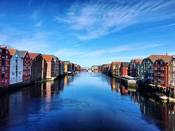 The Nidelva city river flowing through the very heart of Trondheim. Join us on a Sightseeing Tour and drift down these gentle waters in a traditional boat.