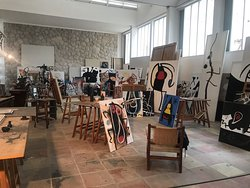 His studio where paintings are stacked just how he left them