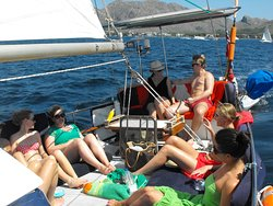 Happy family relaxing on huge deck cushions on the aft deck Plenty of shade under the canopy to keep cool out of the sun if you want