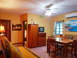 One-Bedroom Apartment: Private Bedroom w/ Queen Bed & 1 Futon Sofa in Living Area