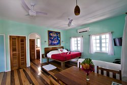 Bougainvillea Bungalow: One King Size Bed & One Pull Out Sofa (opens up to a double bed)