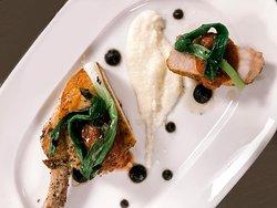 Bone-In Pork Chop robiola polenta | burnt onion puree | spring rhubarb confiture