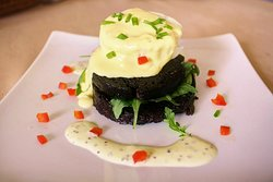 Black pudding and goats cheese stack with hollandaise sauce