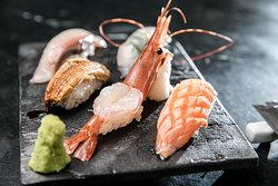 Master Sushi Chef Katayama processes the whirlwind of thoughts and creativity in his mind and settles them into authentic cuisine with intense precision & freshness to transpose assorted seasonal Sashimi, Grilled Salmon with Teriyaki Sauce or Sea Salt and much more…