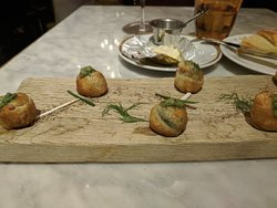 Escargot appetizer.  They are wrapped in a thin pastry.