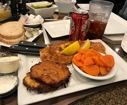Potato flaked flounder, potato pancakes, boiled carrots, rye bread, butter, sour pickles, Dr. Brown's black cherry soda, tartar sauce, sour cream and apple sauce (absent) for the potato pancakes ........... and lemon wedges (for the fish)