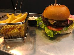 Cheese burger with pickled onions and french fries
