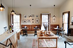 Designed by Laura Schermeister, our tasting room is warm, cozy, and full of interesting art and photographs.