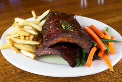 We are home of the best BBQ baby back ribs (prepared with our signature recipe BBQ sauce)