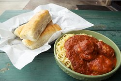 Classic spaghetti & meatball served with breadsticks made in-house