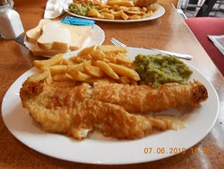 fish and chips with mushy peas and bread and butter